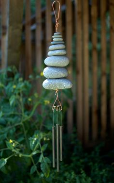 A beautiful natural Pacific beach stones wind chime. This wind chime measures 24 inches long from the top of the copper hook to the bottom of the chimes. The stone section is 8 inches long. The stones