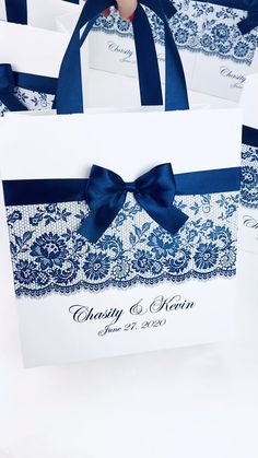 Chic navy blue wedding welcome bags with satin ribbon handles, bow and custom names. Elegant personalized wedding favors for guests Indian Wedding Favors, Elegant Wedding Favors, Edible Wedding Favors, Wedding Gift Bags, Wedding Gifts For Guests, Custom Wedding Gifts, Beach Wedding Favors, Wedding Favor Boxes, Personalized Wedding Gifts