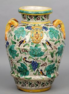 A Large 18th Century Style Italian Maiolica Vase The Body Painted With Brightly Coloured Fruiting Vines Intersd Birds Front Armorial