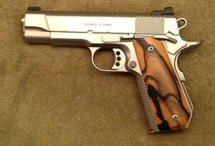 Custom Ed Brown 1911 - http://www.rgrips.com/en/article/72-beretta-al390  If anyone gets a wild hair and wants to buy me one...I would be OK with that!!