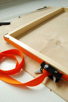 How to Build a Custom DIY Floating Frame for Artwork — Apartment Therapy Tutorials - use a band clamp (shown in photo)works great to secure frame while wood glue dries. Band clamp is good to have if you plan to make more frames.