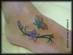 Tattoo butterfly and flowers