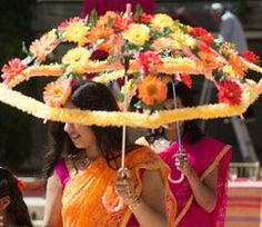 Inspired by the vibrant South Asian wedding wedding palettes, these are great for bridal party entrances.Good idea for an umbrella over table Desi Wedding, Wedding Stage, Wedding Events, Wedding Draping, Wedding Dinner, Garden Wedding, Decoration Evenementielle, Marriage Decoration, Mehndi Party