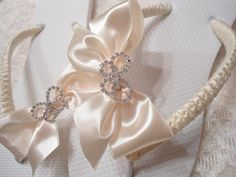 Ivory Bridal Flip Flops embellished with satin bow and butterfly rhinestone.