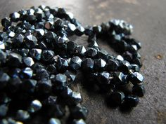 nebula seed. Tiny antique facet-cut beads. by Sparrowsalvage on flickr
