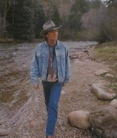 sitting by the banks of a lazy little stream.... oh how I wish it wasn't a dream..... (1st song he ever wrote)