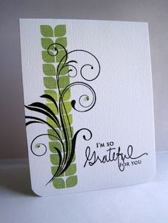 love this simple white card with a big black swirl and a touch of green in the background