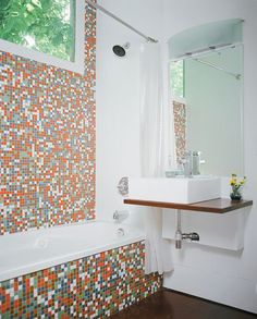 more expensive tile band surrounded by cheaper white tile = mod fabulous...  modwall-bathroom