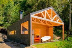 A family wanted to develop their lakeside property in southern Chile with a vacation cabin and a storage shed for small boats, kayaks and related gear. Knowing that the cabin would be used mainly i...