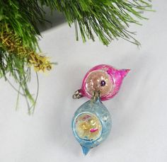 This offering is for a set of 2 pretty little hand blown glass indent teardrop Christmas ornament made in Poland. They are in good vintage condition with no chips or cracks. There is quite a bit of fading and color loss, tons of the vintage charm we all love.  They measure 2.75 inches long and about 1.5 inches deep.  I am happy to combine ship orders and refund shipping overages of $1.00 or more.  Thank you for looking!  To return to my shop, please click below: www.etsy.com/shop/Th...