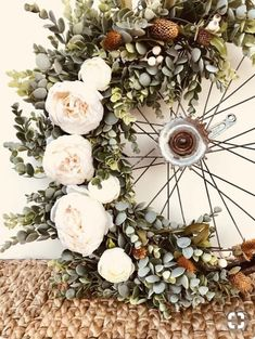 Pretty floral wreath on vintage bike tire. Rustic romance .