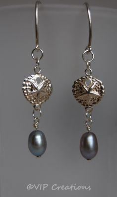 Love, love these earrings - sterling silver sand dollar and  luscious freshwater grey pearls, perfect summer jewelry. $16.00, via Etsy.  www.vipcreations.etsy.com