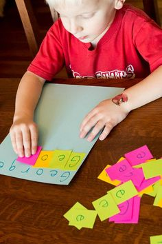 Help your preschooler recognize his name and the letters that it takes to spell his name. - maybe with post-its instead of glue..