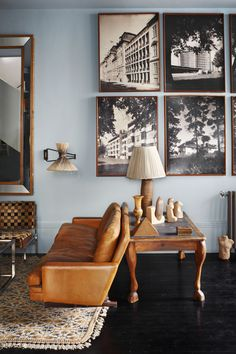 I love the leather seating, black and white photographs and teal wall color mix