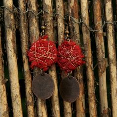 Fabric wrapped earrings using copper wire, copper coins and red fabric. A symbol of self blossom.