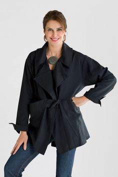 Denim Trench by Ariel Bloom. This washed cotton jacket is an artist's take on a classic trench;a wonderful midweight layer for indoors or out. We love its generous swingy shape and fabulous details that add a touch of sass. Overview: Long sleeves (shown rolled) Below hip length Back pleat detail Oversized collar Distressed seams Single toggle closure Deep draped pockets Artist-made in the U.S.A. Fabric 6), 2 (8;12), or 3 (14;18) Garment measurements: Sleeve Length: 1 (30''), 2 (31''), 3…