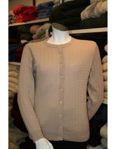 100% Fine Merino Wool lumbar cardigan from Castle Knitwear. Featuring a Baby Cable design.