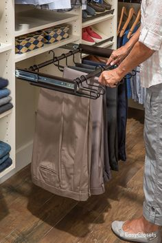 Slide-Out Pant Rack | A slide-out pant rack keeps trousers tidy, organized, and ready to wear.