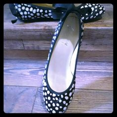 Black & White Poke A Dot Flats Love the look of these shoes, PokeADots not identical. Re-Poshing these. A little tight across the toe/foot joint and I just can't wear them. :( I want these to find a fantastic home. I wear an 8-5, 9 (39) shoe but like I said. A tad too tight across the lower foot toe/foot area. They are maid out of cowhide and have a bow on the back.  Smoke free/pet friendly home. fs/ny Shoes Flats & Loafers