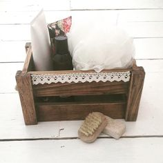 Lovely wooden crate decorated farmhouse chic style to provide pretty and practical storage in the home. This picture is showing the crate as bathroom storage for all your pretty lotions & potions !!