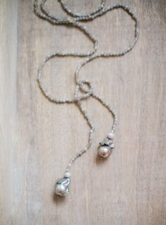 """hand crafted long labradorite necklace with grey baroque pearls at the end. Lariat style, 52"""" in length. For more information @pearrldesigns"""