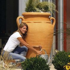 Enhance the look of your backyard with a large, terra cotta-looking flower pot that doubles as a rain barrel. Plant your favorite plants in the top of the planter and use the brass tap on the bottom to water your flowers.