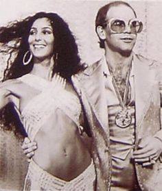 The glitz & outrageous fashions of the 1970s. Cher & Elton looking fab!