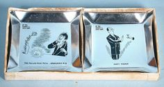 """BY THE DAWN'S UGLY LIGHT"" ASH TRAY & COASTERS SET - 1953 E. Errett Smith Inc. (NY). 3.75"" x 7.25"" x 0.75"" 2-color illustrated box. Box states - ""A pictorial study of the hangover by R. Taylor."". Included are 19 of 24 pressed metal ash tray/coasters (each 3.5"" square). 