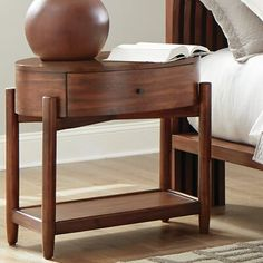 Loon Peak® This transitional-style nightstand is richly designed with smooth oval-shaped tabletop and curved corners. It comes with one drawer and one bottom shelf offer room for convenient storage and organization. With a rich and warm brown finish, it is crafted of solid mahogany and teak veneer frame structure that gives it excellent durability and longevity. Bedroom Furniture Stores, Furniture Deals, Vintage Furniture, Wood Nightstand, Coaster Furniture, Teak Wood, Open Shelving, Solid Wood, Home