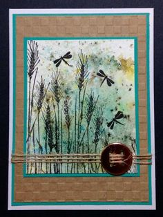 By BarbieP at Splitcoaststampers. Background: Tap Bister powders onto watercolor paper; spritz with water. Dry with heat tool. Stamp grass and dragonflies in VersaFine black ink.