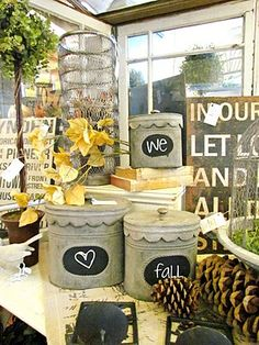 Love These Tin Cans With Chalk Labels Use old ugly canisters found at thrift store. Paint and viola, garden containers. Chalk Labels, Chalkboard Labels, Chalk It Up, Chalk Talk, Liquid Chalk Markers, Country Living Magazine, Love Your Home, Chalkboard Paint, Store Displays