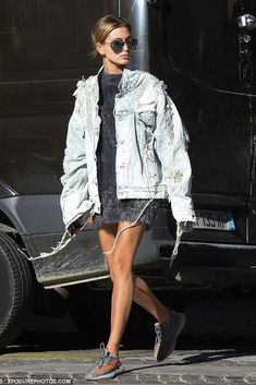 Hailey Baldwin wearing Linda Farrow 425 Aviator Sunglasses in White Gold, Yeezy Boost 350 V2 Sneakers, 5:31 Jerome Spring 2017 Denim Seabed Jacket and Faith Connexion Fuzzy Sweater
