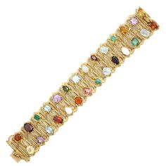 1960s H.Stern Multi-Colored Gemstone Gold Flexible Textured Bracelet | From a unique collection of vintage link bracelets at https://www.1stdibs.com/jewelry/bracelets/link-bracelets/