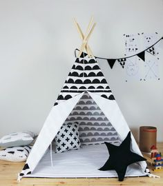 Beautiful indoor play teepee, great for girls or boys. The teepee was handcrafted with utmost care and quality materials. 100% cotton  Dimensions are: