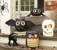 Halloween luminaries ~ hollow papier-mâché figures with water-resistant coating, *for use with flameless candles only ~ different styles/sizes/prices but in general these are consistently offered every year (pictured is partial 2012 offering) | from Pottery Barn Kids
