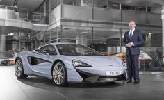 McLaren Automotive CEO Mike Flewitt pictured here with the 10,000th McLaren car - a 570S in Ceramic Grey
