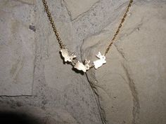 Three Bunnies in a Row Necklace by luvswoodencars2 on Etsy, $15.00