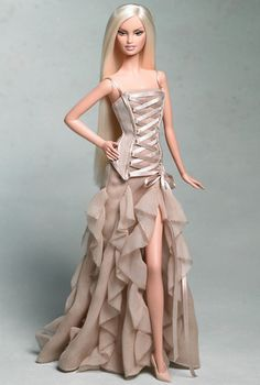 Barbies Best-Ever Designer Collaborations: Versace, 2004.  Donatella Versace in Barbie form. This 2003 lace-up Versace dress burned its way into my pre-teen mind with such a fury, I still haven't forgotten it, and I would still kill for a Barbie in it. Or just my own life-size version.