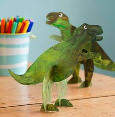Is there a dinosaur lover in your house? This craft is for him--or her! Download our template (familyfunmag.com/printables, May 2013), trace the shapes on cereal box cardboard, cut them out, paint them, and slot them together when the paint is dry.