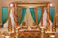 gold turquoise and pearls golden carved mandap in a formal turquoise ...