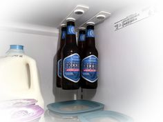 bottleLoft - The world's first magnetic bottle hanger for your refrigerator. Free up some space and make your refrigerator cooler!