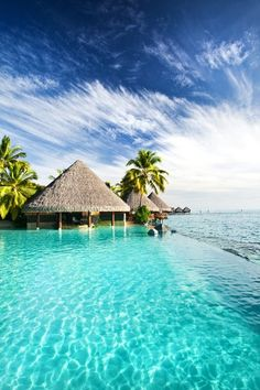 Can you imagine enjoying this crystal blue water on your honeymoon in Tahiti?