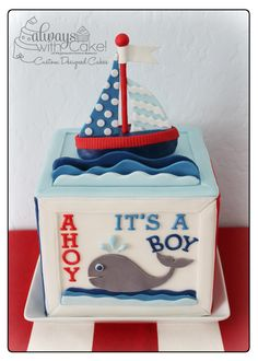 Nautical Baby Block - I was asked to do a cake for a small baby shower, someone was giving at their work.  The customer gave me an invitation and asked me to recreate something from it and this is what I came up with.  Cake is covered in MMF panels.  Boat is made out of rice cereal treats and gumpaste.  TFL