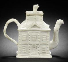 A Staffordshire salt-glazed 'house' teapot and cover, circa 1740-50