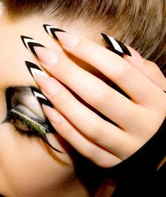 Black and white stiletto nails. Chevron stripes, French tips, sassy eye makeup with feathered lashes and mascara rhinestones. Summer nails, fall nails, long nails. Edge acrylic nails | NAILPRO