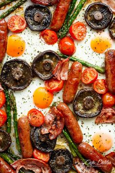 Sheet Pan Full Breakfast complete with eggs, bacon, sausages, tomatoes, asparagus, and GARLIC BUTTER MUSHROOMS! And only one pan to wash up!   https://cafedelites.com