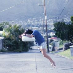 Dreamlike Self-Portraits of a Girl Floating, Falling, and Flying