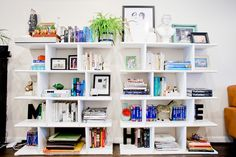 """A DIY Pro Shows Off Her Upgraded Pad #refinery29 """"These white shelves were modeled off of ones I liked at CB2, but they cost $500 each. I found a DIY online and it ended up costing us $125 for two. It was just the cost of the plywood."""""""