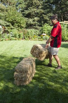 The beginning of a bountiful vegetable garden with Straw  bales... starting with no dirt!