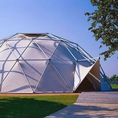 * Buckminster Fuller's Geodesic Dome and Other Forward-Looking Architecture * In 1975 Fuller collaborated with Thomas C. Howard on a dome for Charter Industries that was long used as a car showroom in Detroit. Today the tent construction, where aluminum rods are connected through a plug in system, resides at Vitra's campus in Weil am Rhein, Germany.